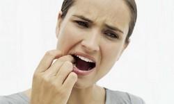Dente inflamado sintomas
