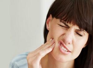 como aliviar dor de dente forte