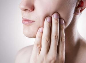desinchar dente inflamado