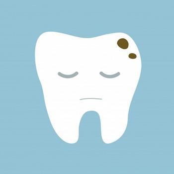 Mancha escura no dente perto da gengiva